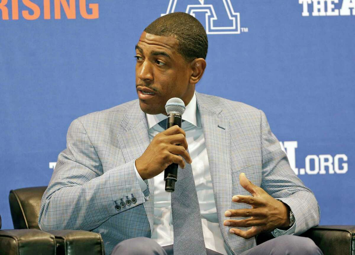 Connecticut head coach Kevin Ollie makes comments during the American Athletic Conference NCAA college basketball media day on Oct. 27, 2015 in Orlando, Fla.