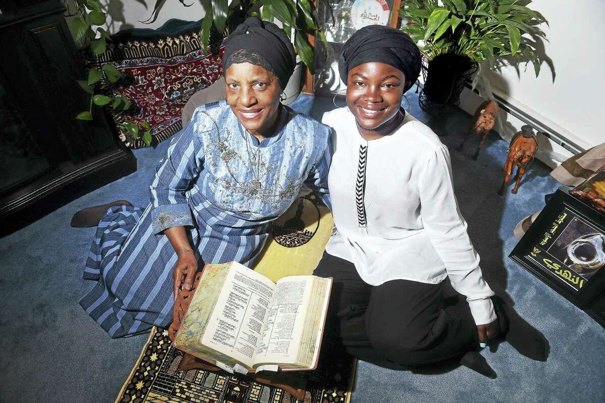(Arnold Gold-New Haven Register) Zakiyyah Hasan (left) and her granddaughter, Sakima Hasan, are photographed sitting on a prayer rug next to the Quaran in Hamden on 6/3/2016.