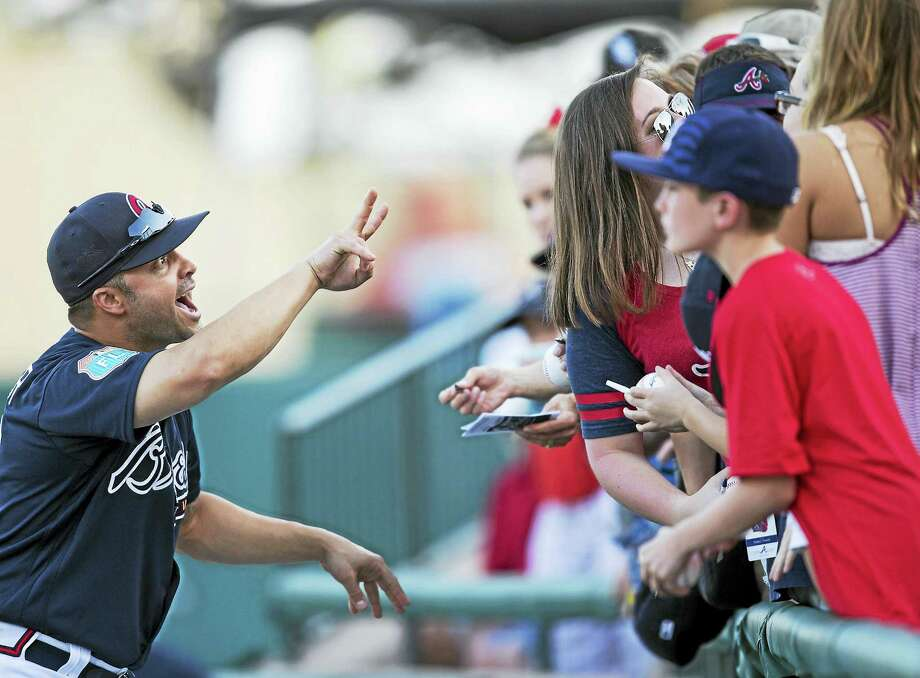 Nick Swisher is seen here in March as a member of the Atlanta Braves. Photo: The Associated Press File Photo  / FR170803 AP