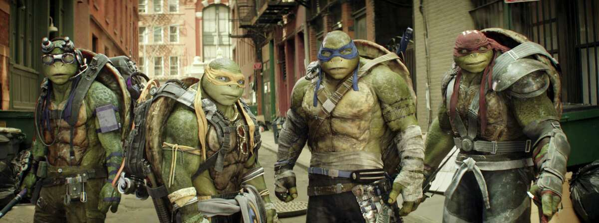 """This image released by Paramount Pictures shows, from left, Donatello, Michelangelo, Leonardo and Raphael in a scene from """"Teenage Mutant Ninja Turtles: Out of the Shadows."""" The movie opened to $35.3 million according to comScore estimates Sunday, June 5, 2016, close to half of what the first film opened to in 2014."""