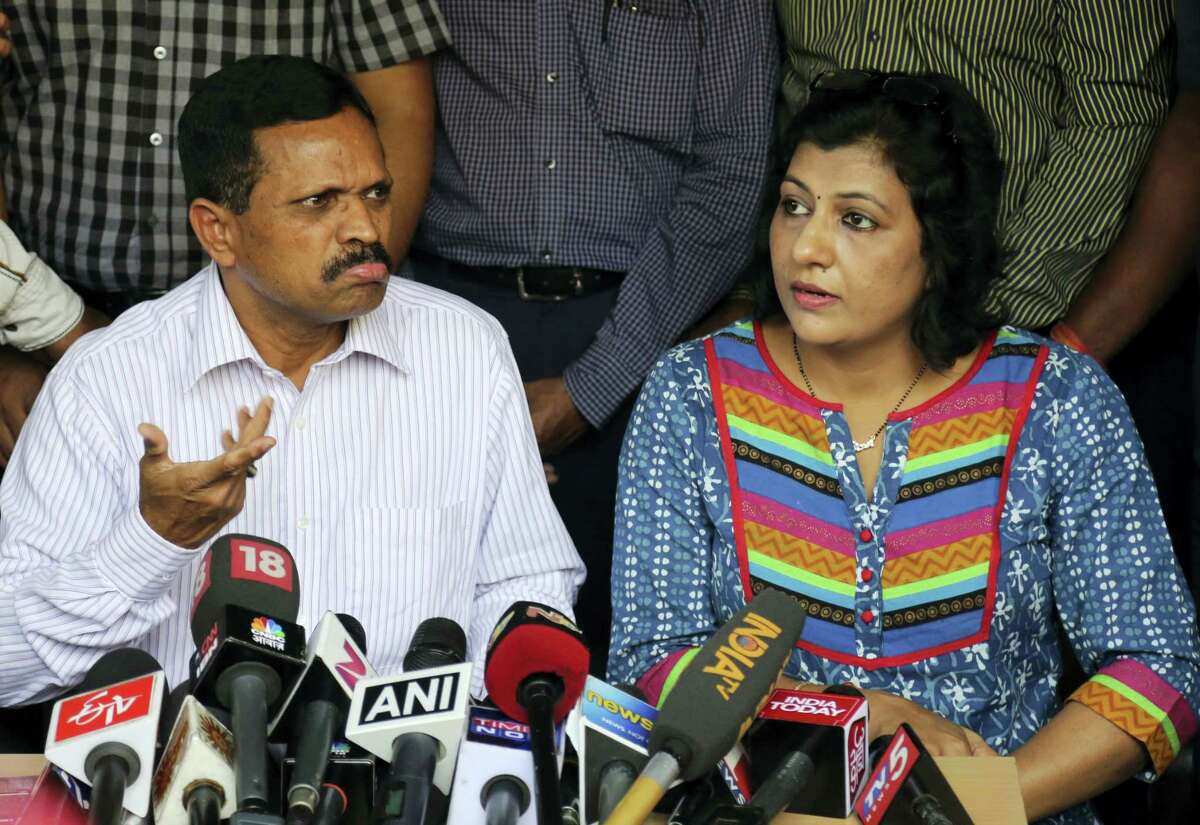 K Panduranga Rao, left, group head of human resources and administration, and Sita, legal head of IVRCL, the company that was constructing the underpass in Kolkata, that collapsed partially on Thursday, March 31, address the media at their office in Hyderabad, India, Friday, April 1, 2016. Police detained five officials from IVRCL, contracted in 2007 to build the overpass, and sealed its Kolkata office.