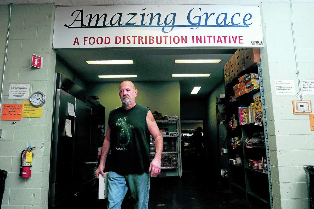 File photo A volunteer works at the Amazing Grace Food Pantry in Middletown.