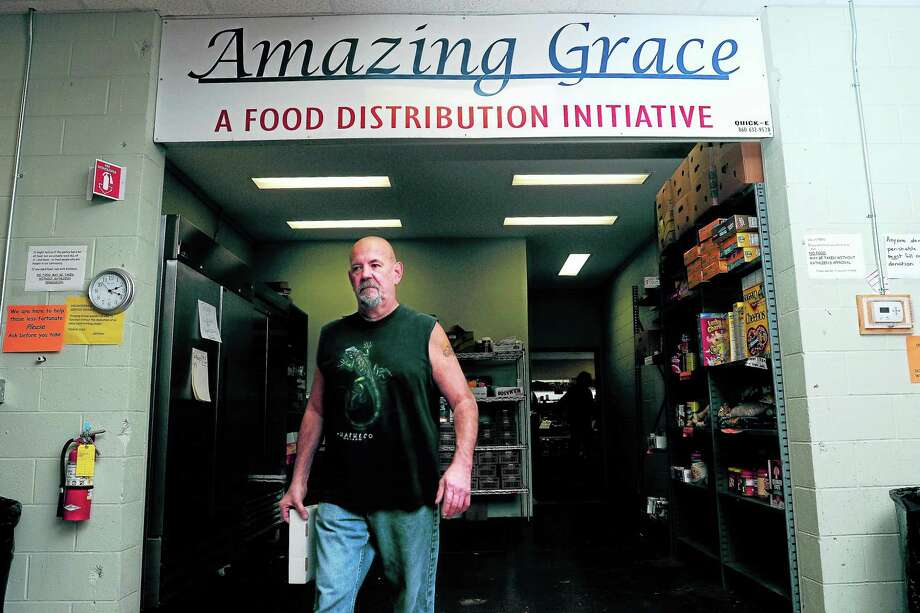 File photo A volunteer works at the Amazing Grace Food Pantry in Middletown. Photo: Journal Register Co.