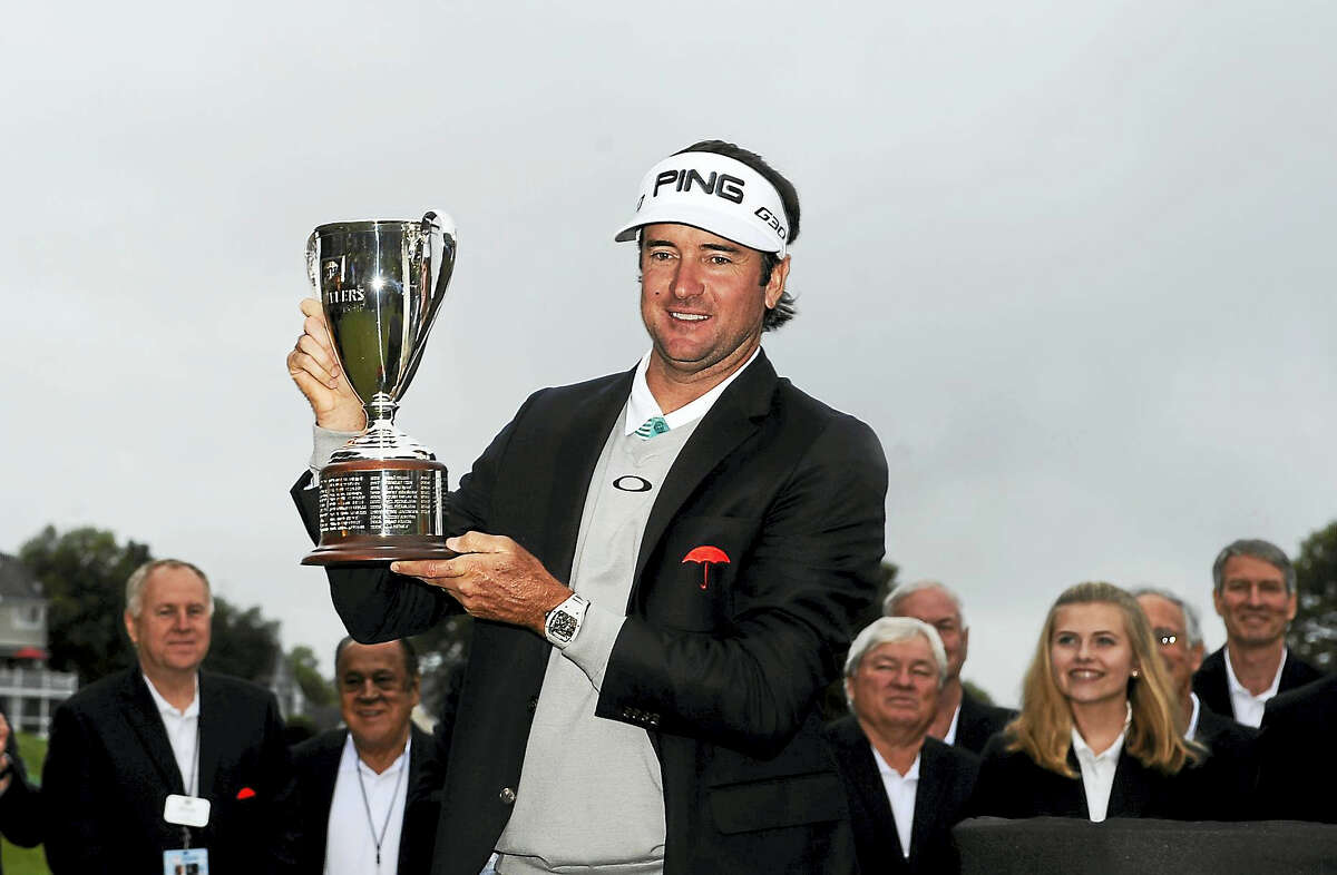 Bubba Watson holds the championship trophy after winning the 2015 Travelers Championship.