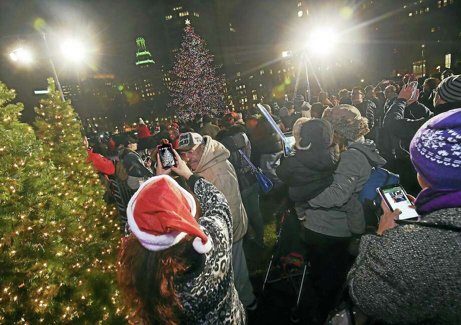 Crowds turned out for the city's annual lighting of the Christmas tree Thursday on the New Haven Green. Photo: Catherine Avalone — New Haven Register  / New Haven RegisterThe Middletown Press