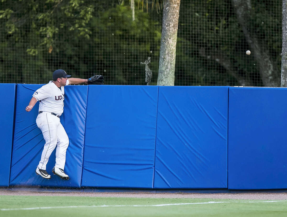 UConn's Joe DeRoche-Duffin cannot snag Florida's Danny Reyes's home run during Saturday's game.