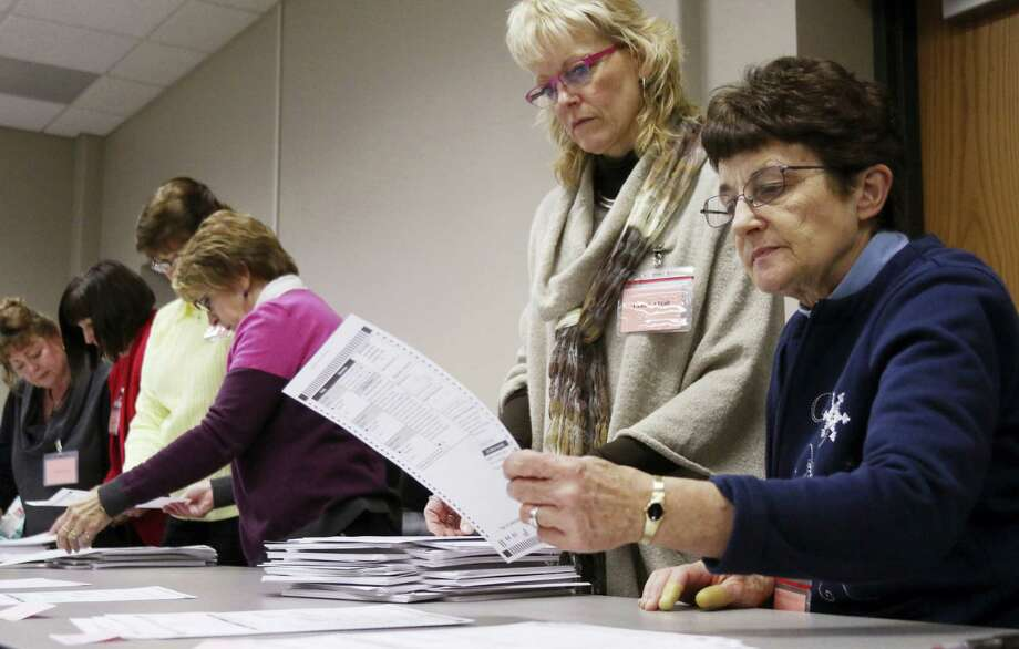 Tabulator Claudette Moll, right, from Farmington, looks over a ballot during a statewide presidential election recount Thursday, Dec. 1, 2016, West Bend, Wis. Photo: John Ehlke/West Bend Daily News Via AP   / Conley Media