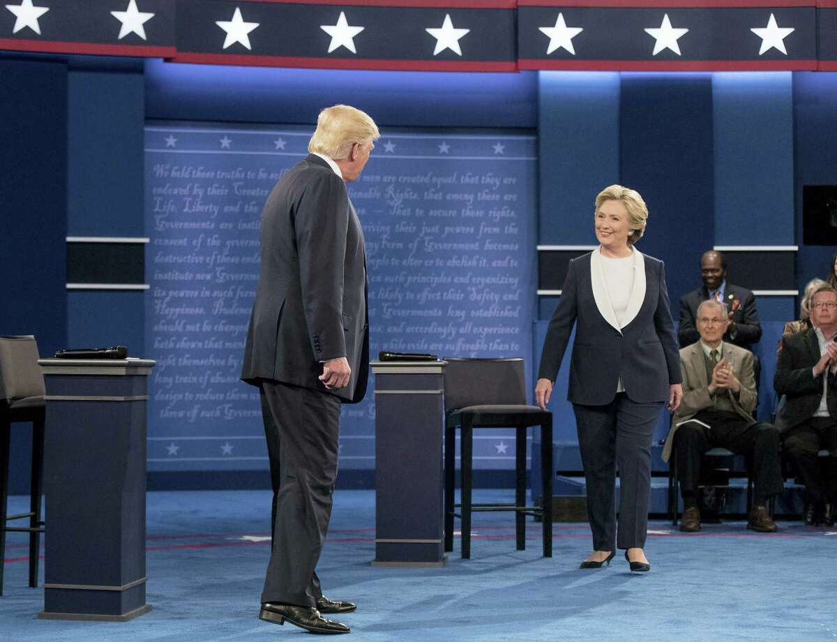 Democratic presidential candidate Hillary Clinton and Republican presidential candidate Donald Trump greet each other at the second presidential debate at Washington University on Oct. 9, 2016 in St. Louis.