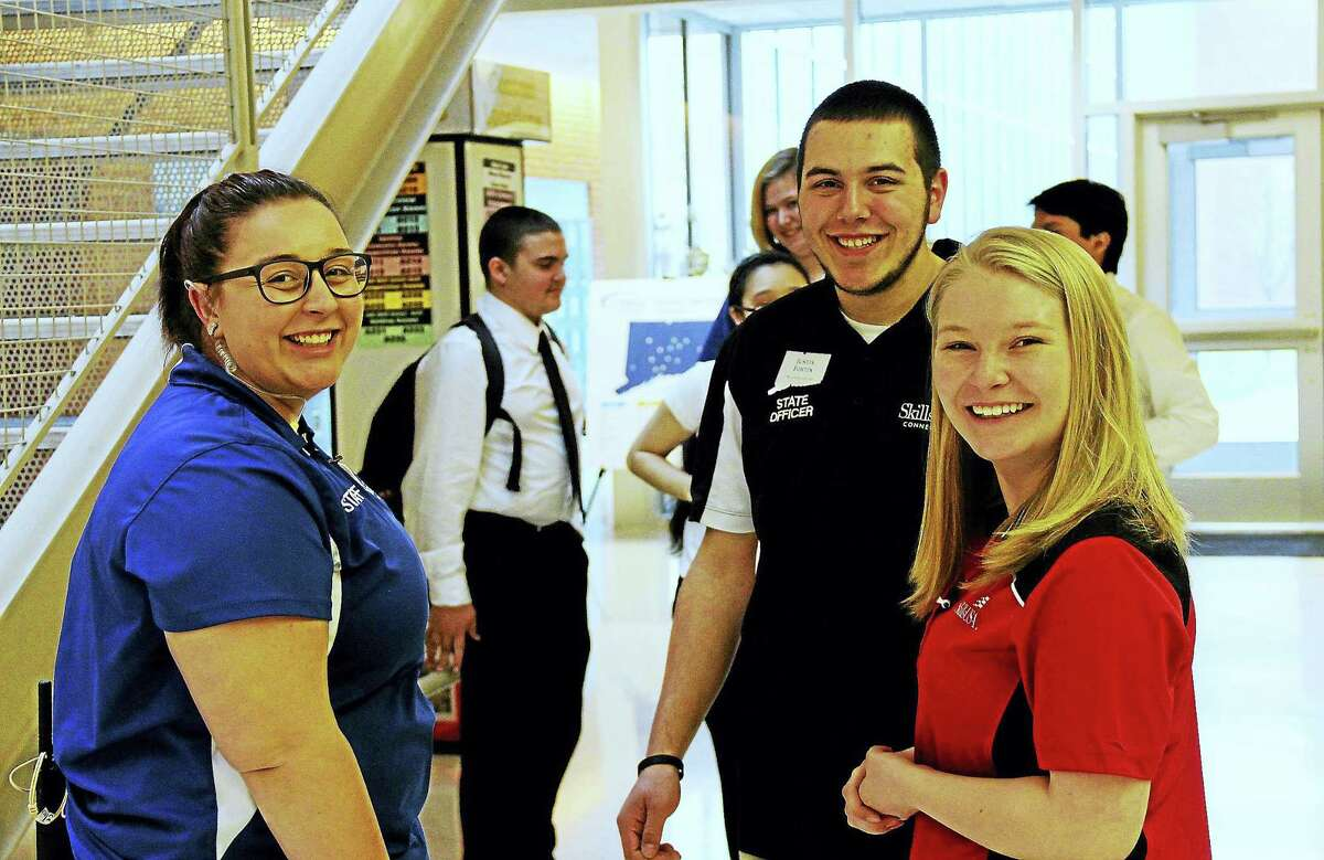 Middletown resident Amanda Balch, left, shares a moment with other teen SkillsUSA Connecticut volunteers Friday during the 39th annual Leadership Conference at Wilcox Tech high school in Meriden.