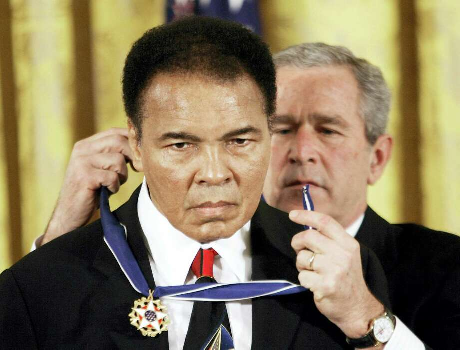 President Bush presents the Presidential Medal of Freedom to boxer Muhammad Ali in the East Room of the White House. Ali, the magnificent heavyweight champion whose fast fists and irrepressible personality transcended sports and captivated the world, has died according to a statement released by his family Friday, June 3, 2016. He was 74. Photo: AP Photo — Evan Vucci, File / Copyright 2016 The Associated Press. All rights reserved. This material may not be published, broadcast, rewritten or redistribu