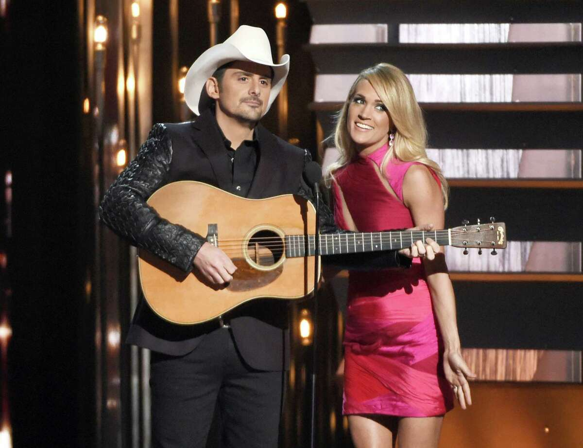 In this Nov. 4, 2015 photo, hosts Brad Paisley, left, and Carrie Underwood speak at the 49th annual CMA Awards in Nashville, Tenn. Paisley and Underwood, along with Dierks Bentley, Eric Church, Maren Morris and Keith Urban will perform at the 50th annual Country Music Association Awards show on Nov. 2.