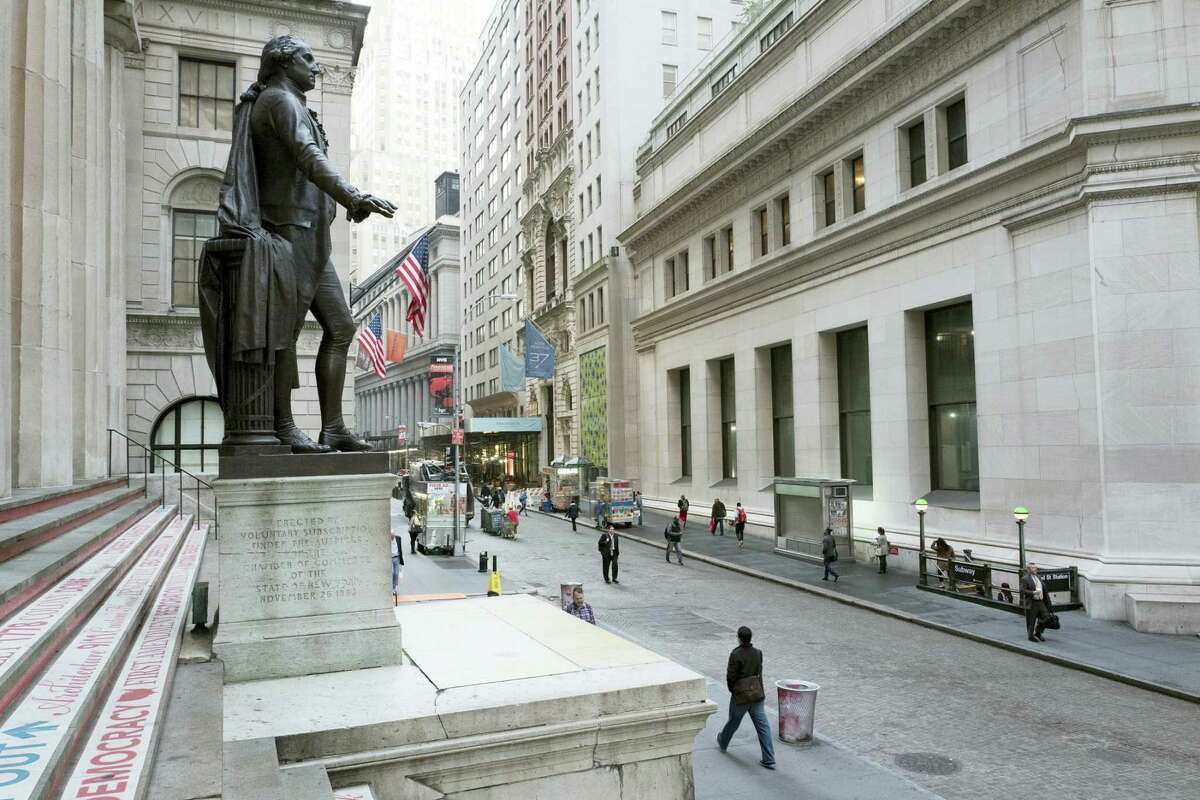 A statue of George Washington is poised above Wall Street, in New York.