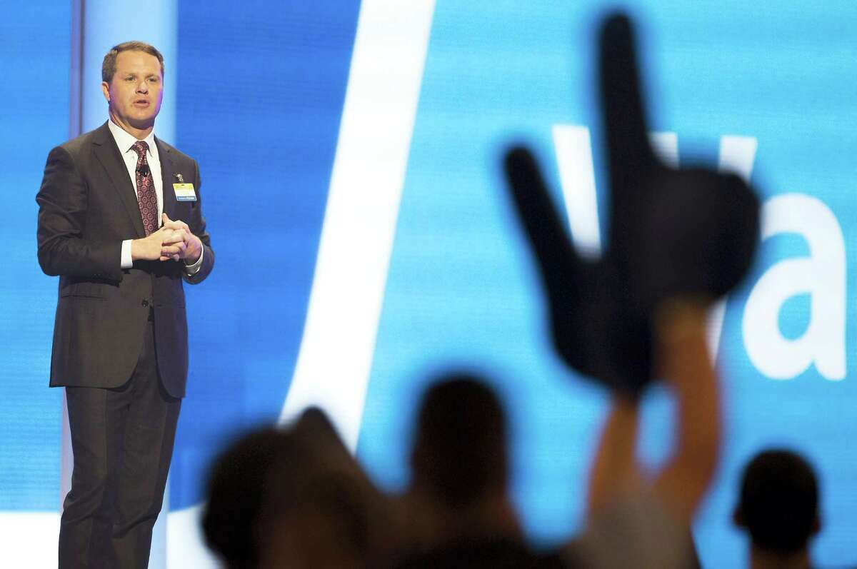 Doug McMillon, Wal-Mart chief executive officer and president, talks on stage during the annual Wal-Mart Shareholders Meeting Friday in Fayetteville, Ark.