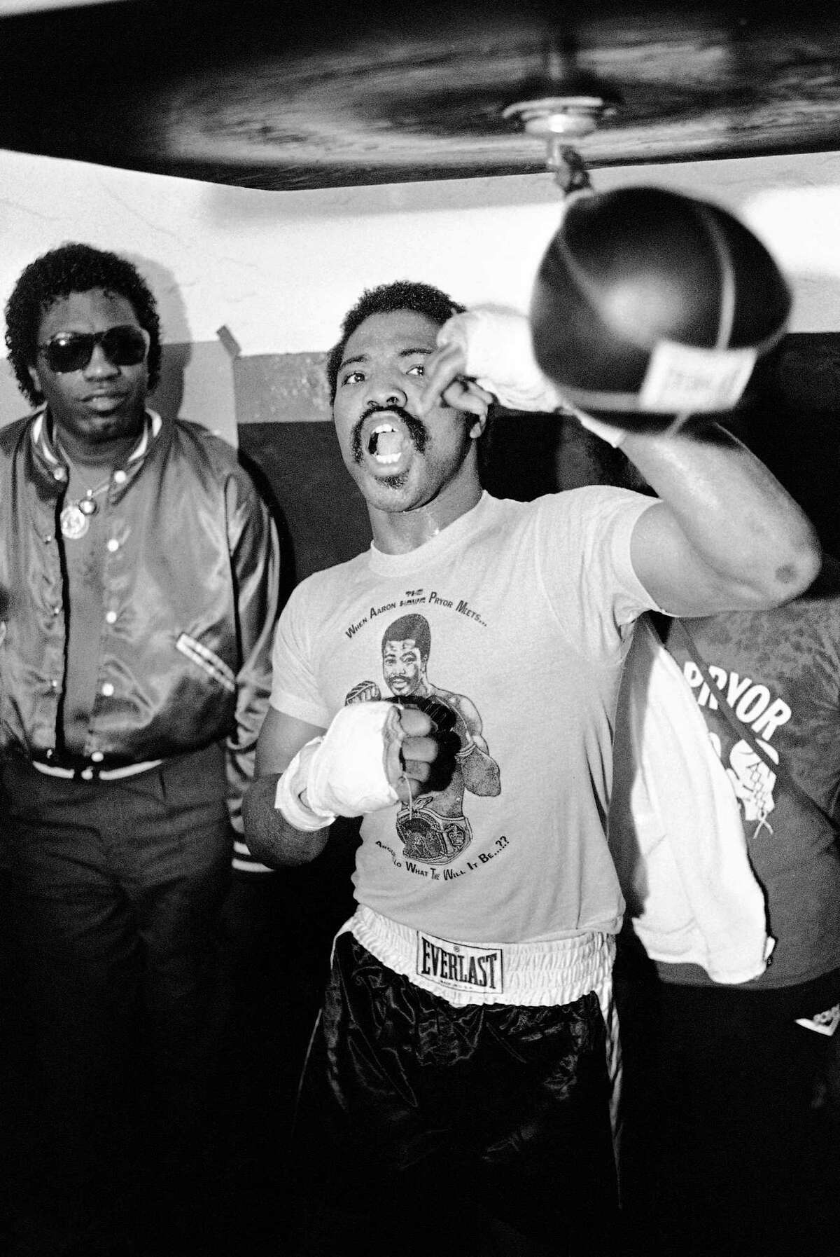 In this photo from 1982, Aaron Pryor yells as he trains on the speed bag at his Coconut Grove training camp in Miami.
