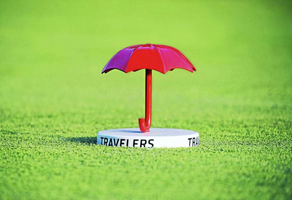 Three players shared the lead after the first round of the Travelers Championship on Thursday.