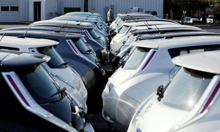Nissan electric vehicles sit on display at an auto dealership in Roswell, Ga. Photo: David Goldman — The Associated Press File Photo  / Copyright 2016 The Associated Press. All rights reserved. This material may not be published, broadcast, rewritten or redistributed without permission.