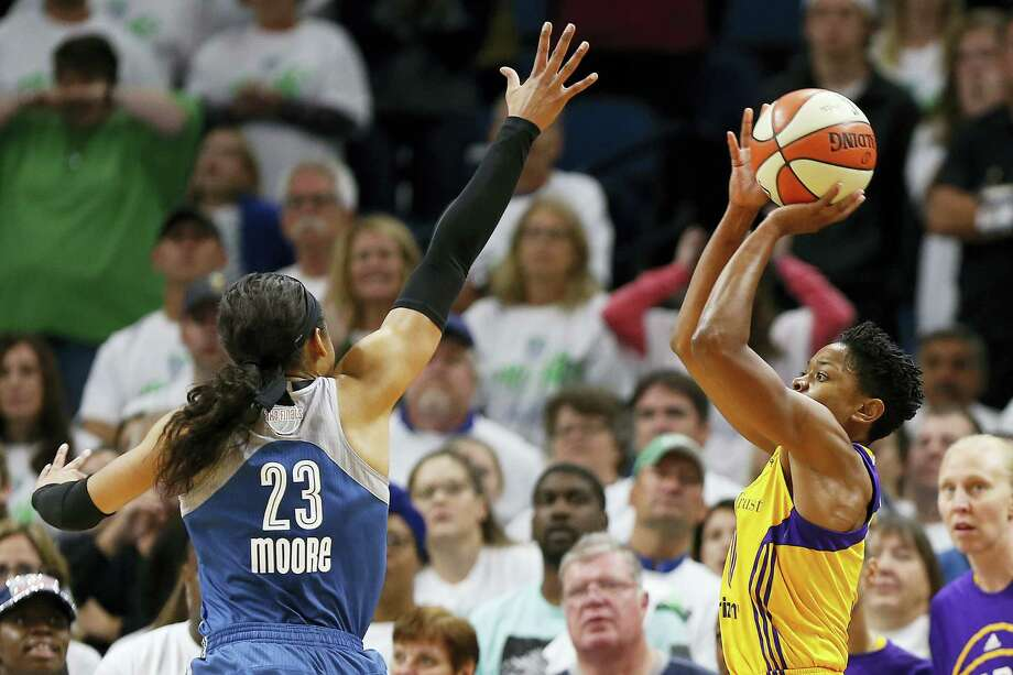 Los Angeles Sparks guard Alana Beard, right, lines up the game-winning shot against Minnesota Lynx forward Maya Moore on Sunday. Photo: Stacy Bengs — The Associated Press  / FR170489 AP