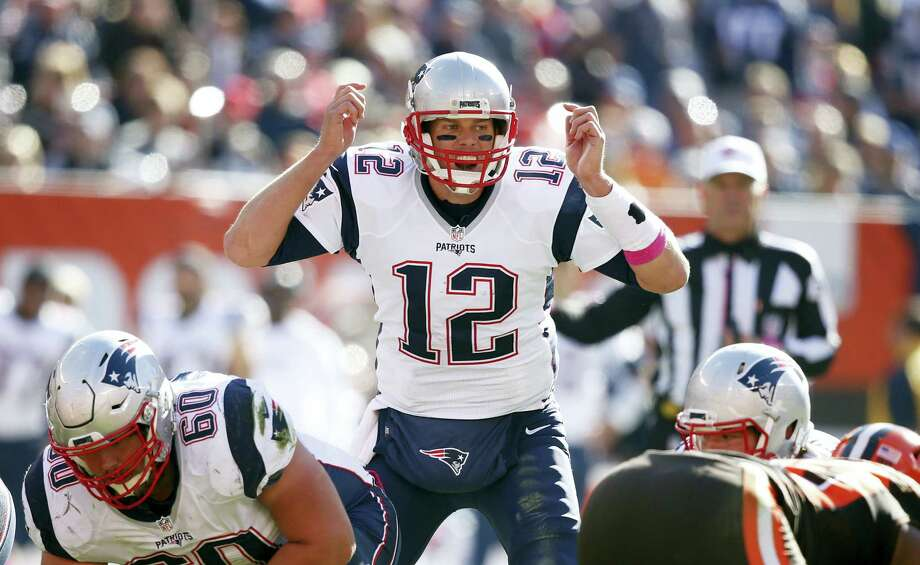 Patriots quarterback Tom Brady shouts at the line in the second half of Sunday's win over the Browns. Photo: Ron Schwane — The Associated Press  / FR78273 AP
