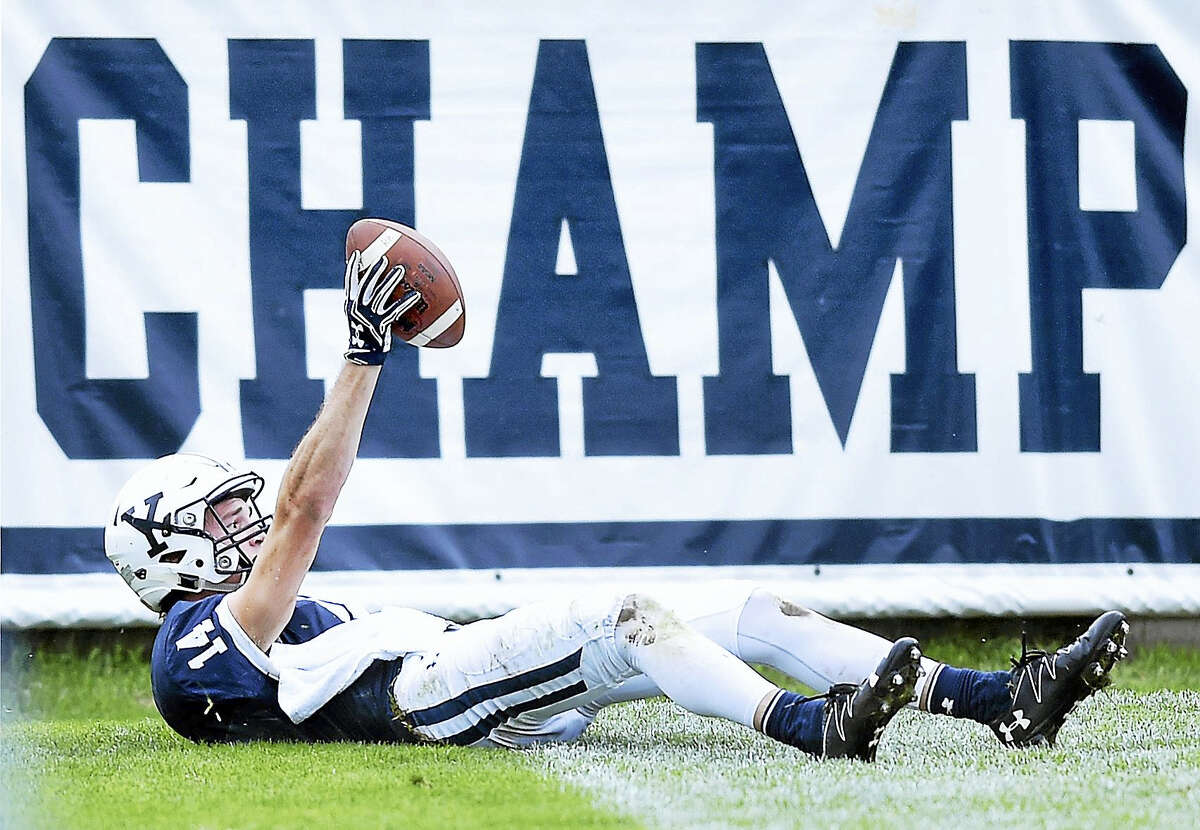 Yale's Reed Klubnik shows the ball after catching a touchdown pass near the end of the first half.