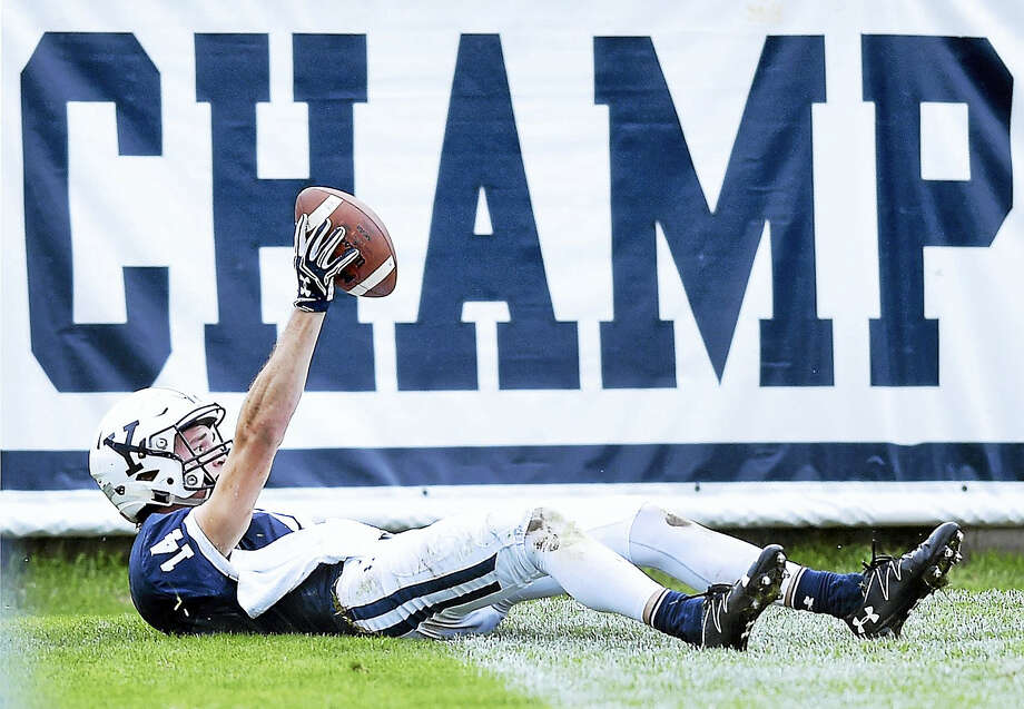 Yale's Reed Klubnik shows the ball after catching a touchdown pass near the end of the first half. Photo: Arnold Gold — Register