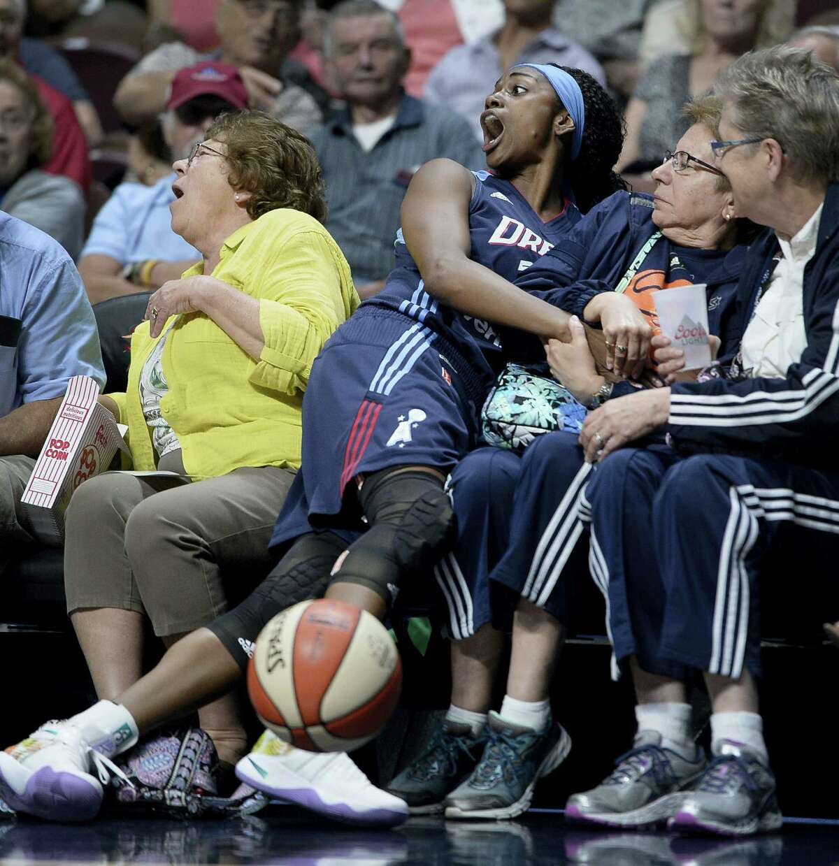 Tiffany Hayes reacts as she falls out of bounds during the first half on Friday.