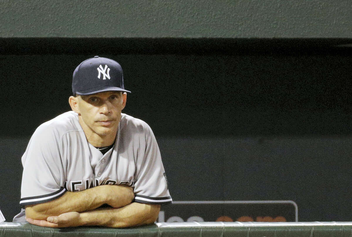 Yankees manager Joe Girardi stands in the dugout in the eighth inning Friday.