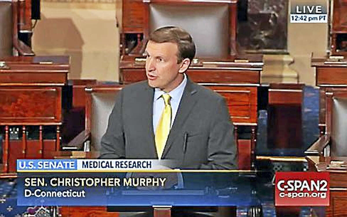U.S. Sen. Chris Murphy talks about mental health reform on the floor of the Senate Wednesday, Nov. 30
