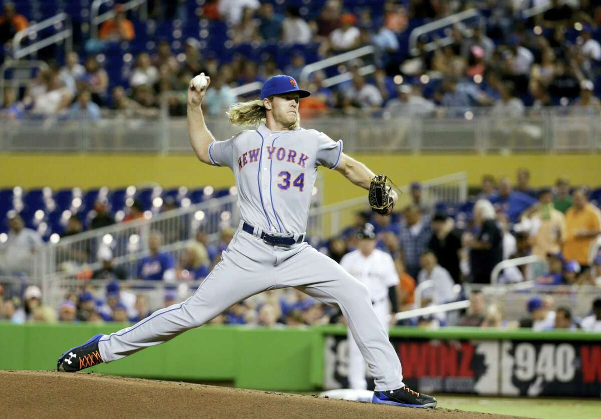 Noah Syndergaard delivers a pitch during the first inning on Friday.