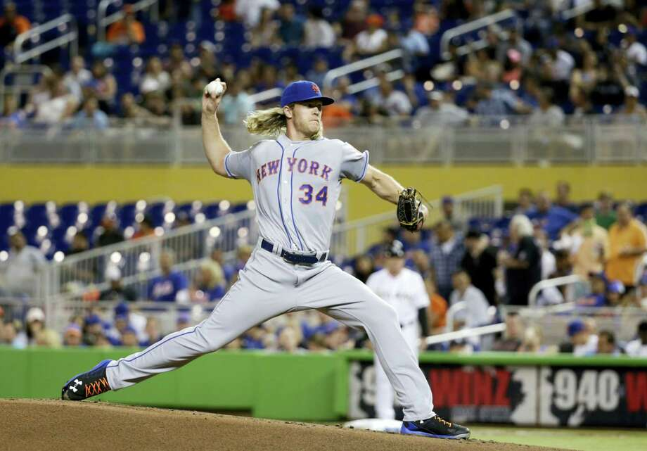 Noah Syndergaard delivers a pitch during the first inning on Friday. Photo: Wilfredo Lee — The Associated Press  / Copyright 2016 The Associated Press. All rights reserved. This material may not be published, broadcast, rewritten or redistribu