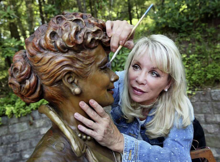 """In this Wednesday, July 20, 2016, photo, artist Carolyn Palmer prepares to apply a cold patina to her bronze statue of Lucille Ball in Saddle River, N.J. The sculptor was chosen to create a replacement statue for one dubbed """"Scary Lucy,"""" in the late actress Ball's hometown. The much-maligned statue of Ball will be replaced after it drew worldwide attention as """"Scary Lucy,"""" according to the mayor of the western New York village where the 1950s sitcom actress and comedian grew up and her life-size bronze has stood since 2009. Photo: AP Photo/Mel Evans   / Copyright 2016 The Associated Press. All rights reserved. This material may not be published, broadcast, rewritten or redistribu"""