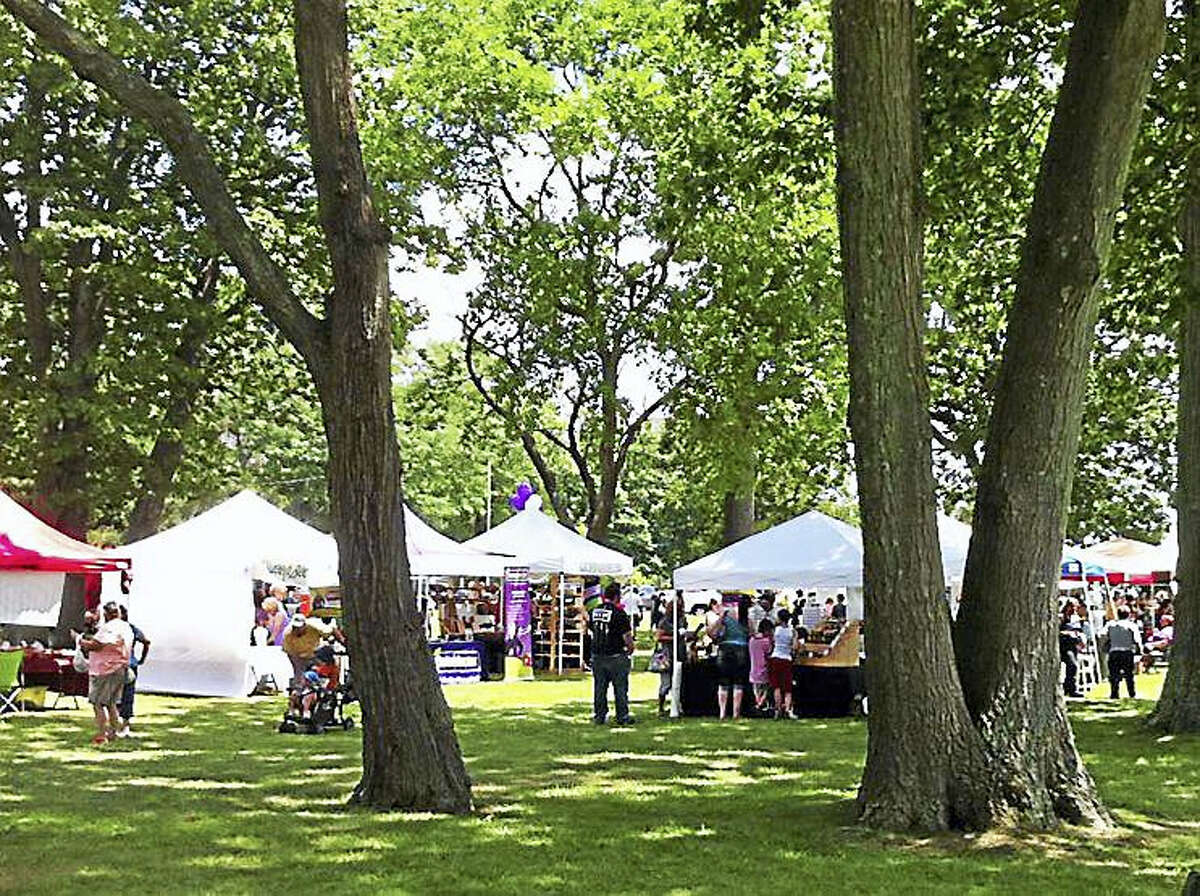 Under the trees at the Walnut Beach Arts & Crafts Festival in Milford.