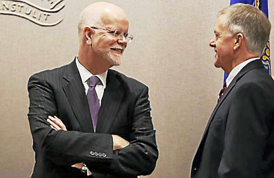 State Comptroller Kevin Lembo chats before the Bond Commission meeting. Photo: Christine Stuart — CT News Junkie File Photo
