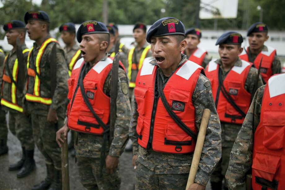 Guatemalan army soldiers sing as they stand for review at their base, before the arrival of Hurricane Earl in Puerto Barrios, Guatemala, Tuesday, Aug. 3, 2016. Hurricane Earl bore down on the coast of the Caribbean nation of Belize with the danger of high surf and winds, while also threatening neighboring Guatemala and southern Mexico with torrential rains. Earl has since been downgraded to a tropical storm. Photo: AP Photo/Luis Soto   / Copyright 2016 The Associated Press. All rights reserved. This material may not be published, broadcast, rewritten or redistribu