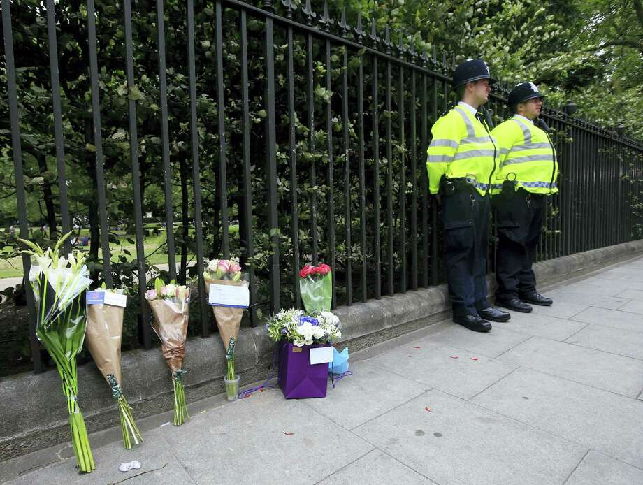 Floral tributes rest against railings Thursday Aug. 4, 2016, near the scene of a fatal stabbing on Wednesday night in Russell Square, London. London police say they have found no signs of radicalization in a knife attack which killed an American woman and injured five other people in London's Russell Square. Photo: Jonathan Brady/PA Via AP   / PA
