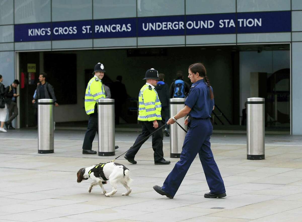 Jonathan Brady/PA via AP A police officer and sniffer dog patrol outside King's Cross St Pancras underground station in London Thursday Aug. 4, 2016. Police put more officers on London streets Thursday after a man stabbed a woman to death and injured five other people near the British Museum, just days after authorities had warned the public to be vigilant in light of attacks in other parts of Europe.