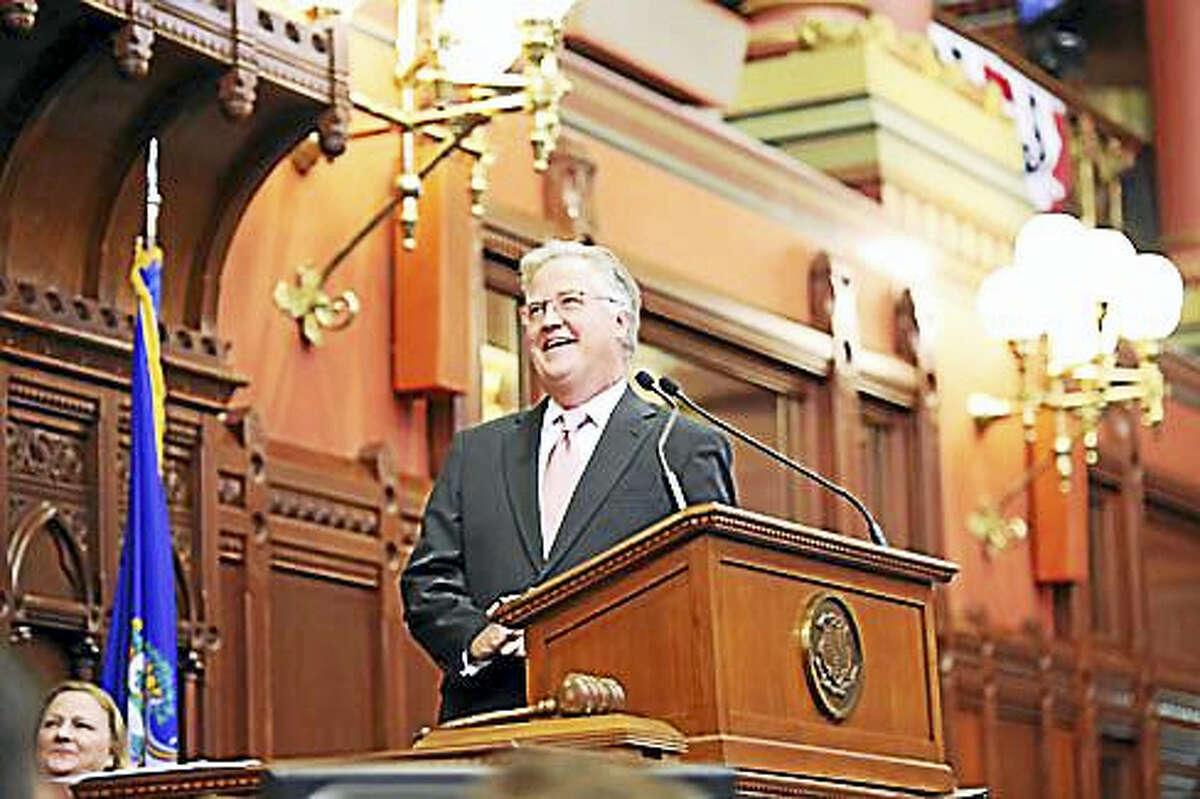 House Speaker Brendan Sharkey watches the video tribute.