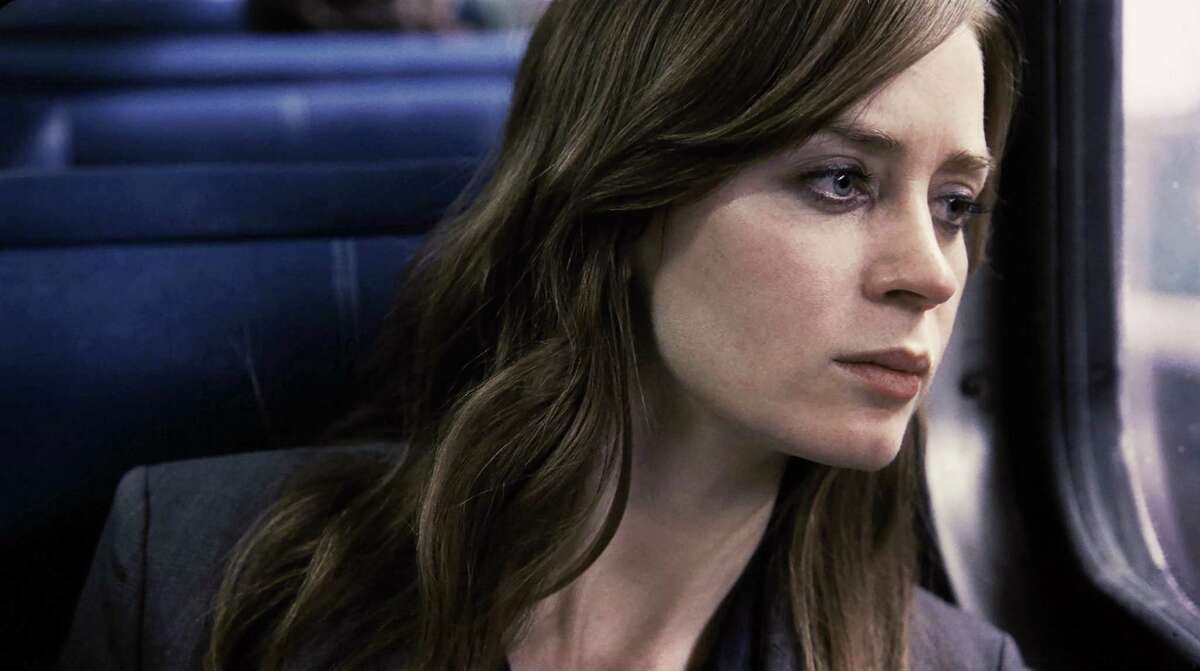 """In this file image, released by Universal Pictures, Emily Blunt appears in a scene from, """"The Girl on the Train."""" Propelled by the popularity of Paula Hawkins' best-seller, the adaptation of """"The Girl on the Train"""" led North American theaters in ticket sales with $24.7 million, according to studio estimates on Oct. 9, 2016."""