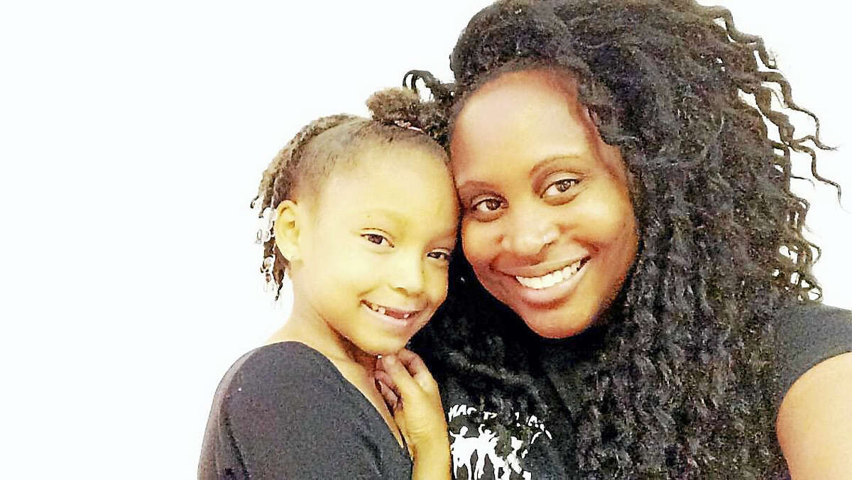 Middletown resident Leah Maille, owner of Stage Left Dance studio, poses with dance student Jaleah Johnson. The 26-year-old entrepreneur recently purchased a second studio, the Dancers Image in Cromwell.