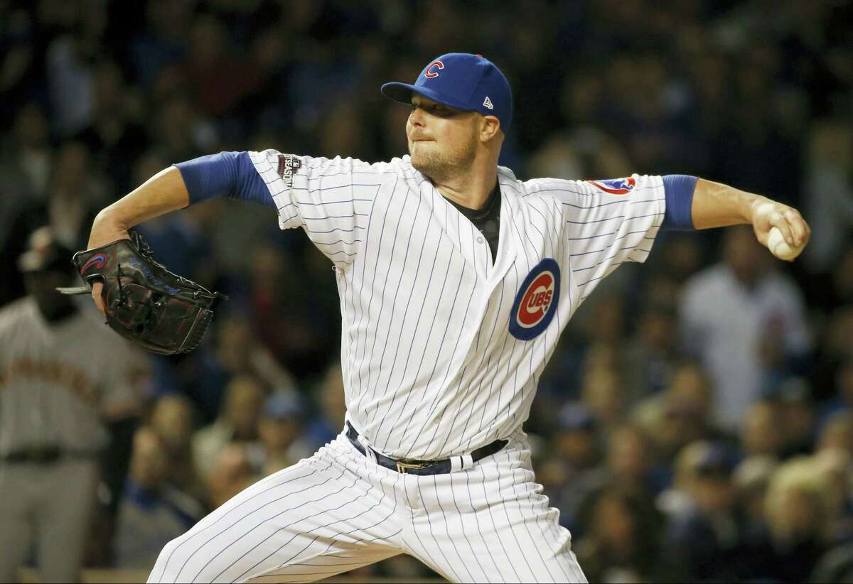 Cubs starting pitcher Jon Lester (34) throws in the first inning on Friday.