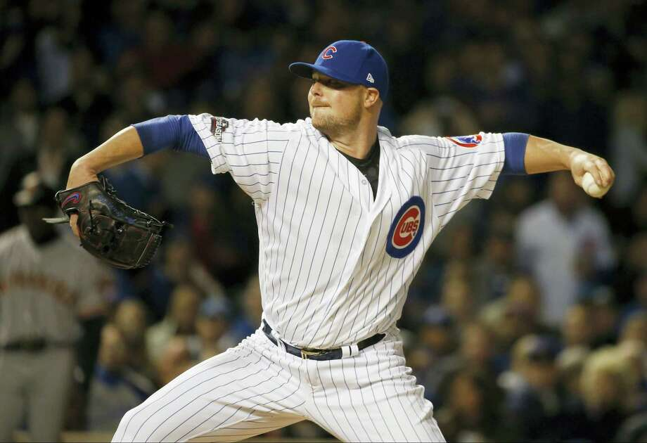 Cubs starting pitcher Jon Lester (34) throws in the first inning on Friday. Photo: Nam Y. Huh — The Associated Press  / Copyright 2016 The Associated Press. All rights reserved.