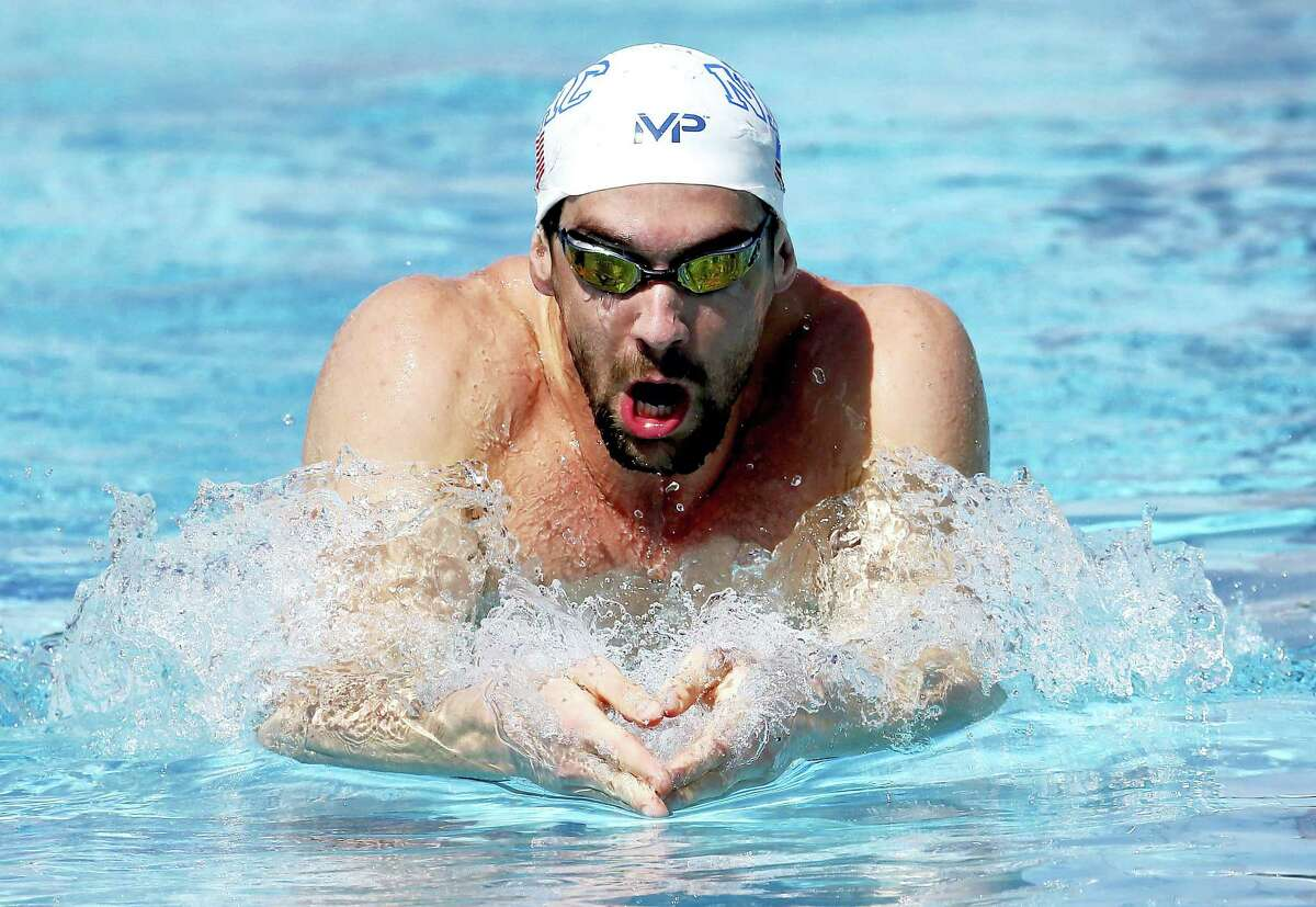Michael Phelps swims laps during a practice session on April 15, 2015 in Mesa, Ariz.