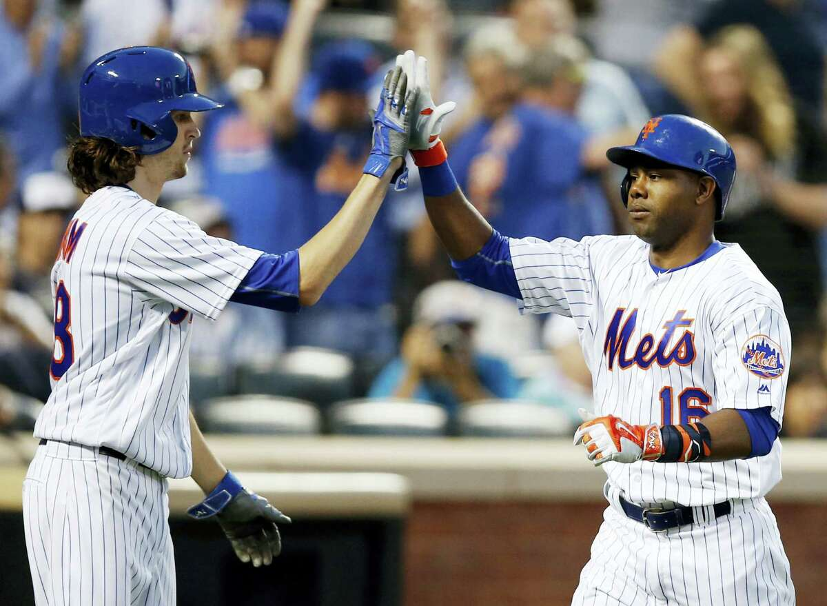 New York Mets Jacob deGrom, left, greets Alejandro De Aza after scoring on de Aza's third-inning two-run home run Tuesday in New York. The Mets won 7-1.
