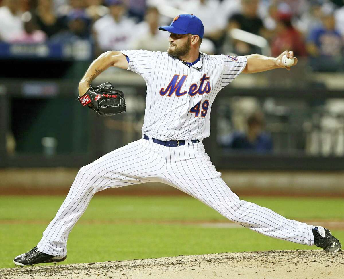 New York Mets relief pitcher Jonathon Niese winds up in the ninth inning against the New York Yankees Tuesday in New York. The Mets won 7-1.