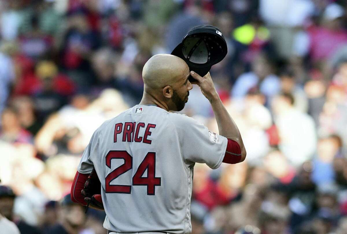 Red Sox pitcher David Price reacts after allowing a home run to the Indians' Lonnie Chisenhall in the second inning of Game 2 of the American League Division Series on Friday in Cleveland.