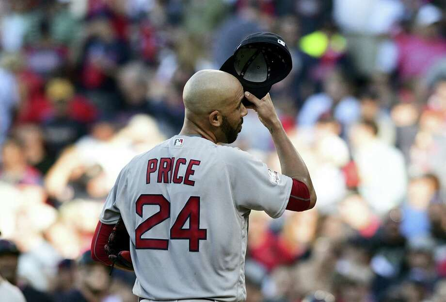 Red Sox pitcher David Price reacts after allowing a home run to the Indians' Lonnie Chisenhall in the second inning of Game 2 of the American League Division Series on Friday in Cleveland. Photo: The Associated Press   / FR171035 AP