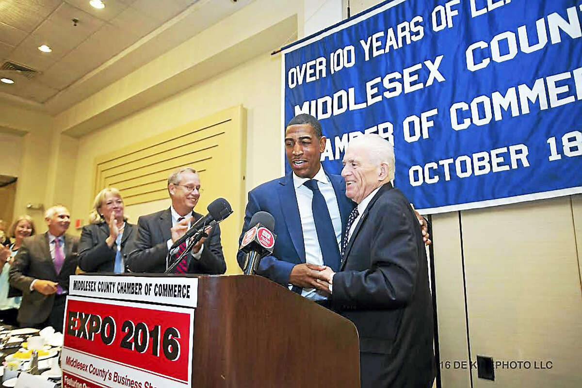 President of the Middlesex County Chamber of Commerce Larry McHugh greets UConn Men's Basketball Coach Kevin Ollie at the October member breakfast. To the left of Ollie is Chairman of the Middlesex County Chamber of Gregory Shook, Senior Vice President of Chief Sales & Marketing Officer of ConnectiCare Bert Wachtelhausen, President of Connecticut State Colleges & Universities Mark Ojakian and President of Middlesex Community College Anna Wasescha.