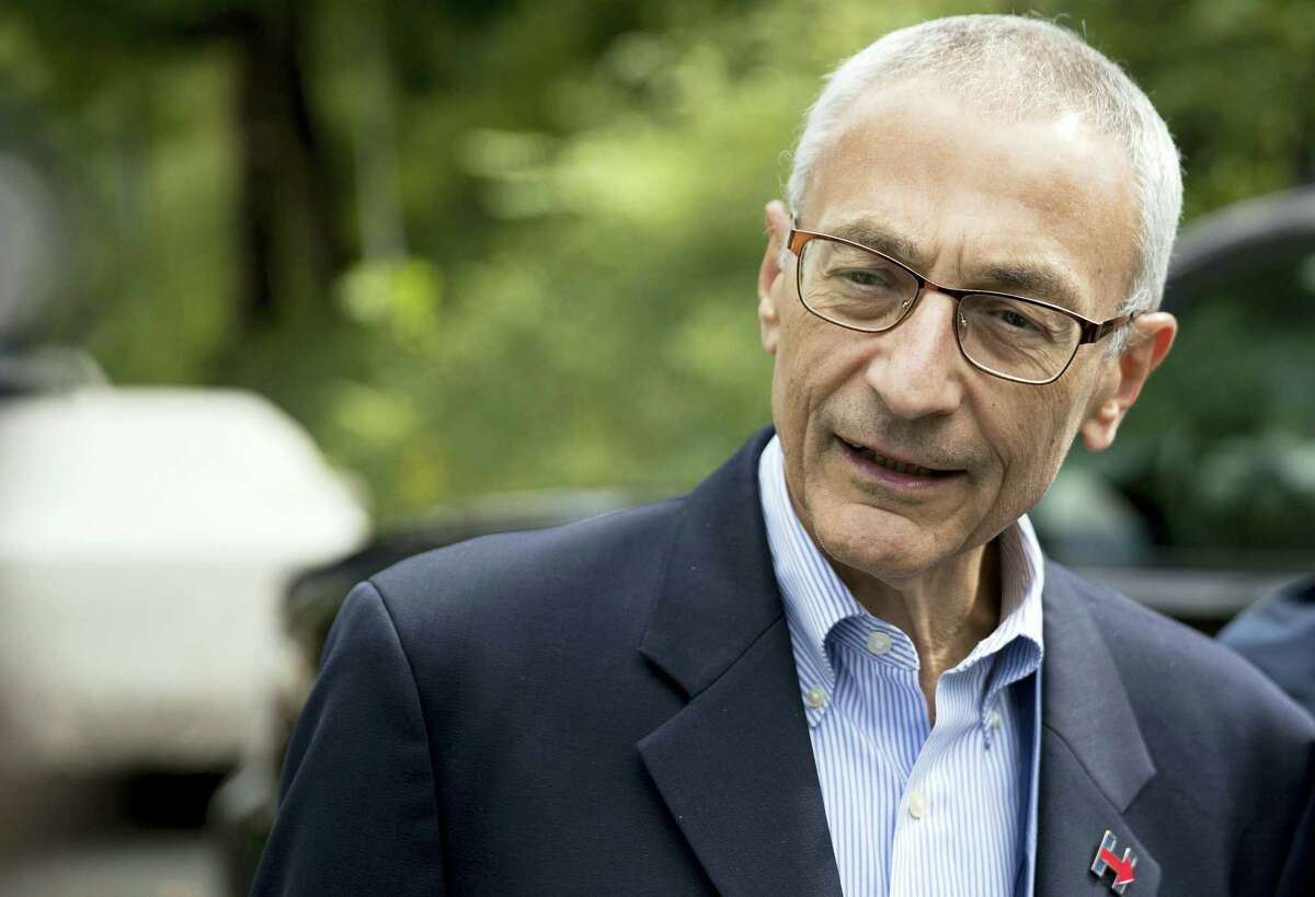 In this Oct. 5, 2016, photo, Hillary Clinton campaign chairman John Podesta speaks to members of the media outside Clinton's home in Washington. The WikiLeaks organization on Oct. 7, posted what it said were thousands of emails from Podesta, including some with excerpts from speeches she gave to Wall Street executives and others 'Äî speeches she has declined to release despite demands from Trump.