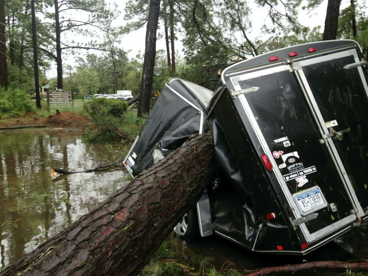 A trailer is destroyed from a fallen tree in the aftermath of Hurricane Matthew at Hilton Head, S.C., on Saturday, Oct. 8, 2016. Matthew plowed north along the Atlantic coast, flooding towns and gouging out roads in its path.