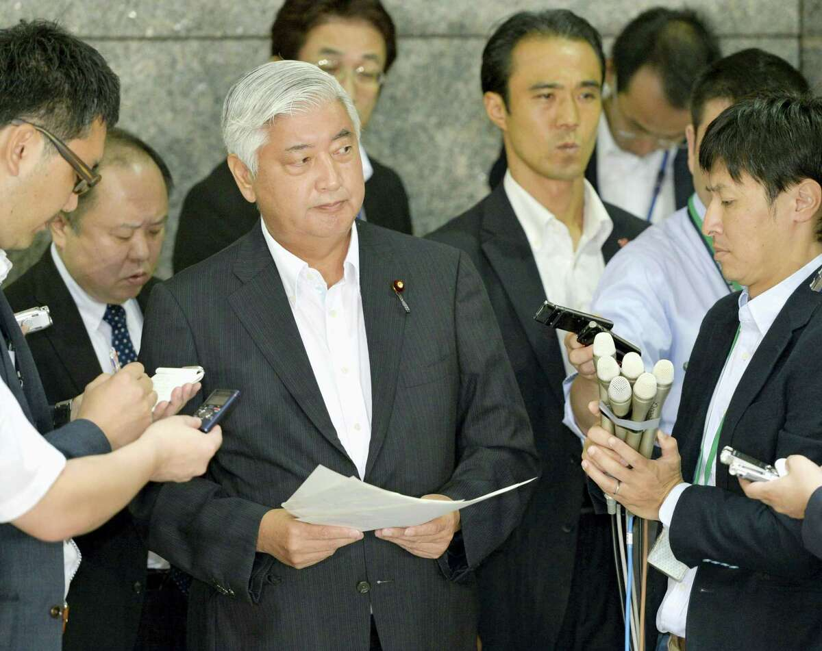 Japan's Defense Minister Gen Nakatani, center, speaks to the media regarding Wednesday's missile launch by North Korea, at his ministry in Tokyo on Aug. 3, 2016. North Korea fired a ballistic missile into the sea on Wednesday, South Korea's military said, the fourth reported weapons launch the North has carried out in about two weeks.