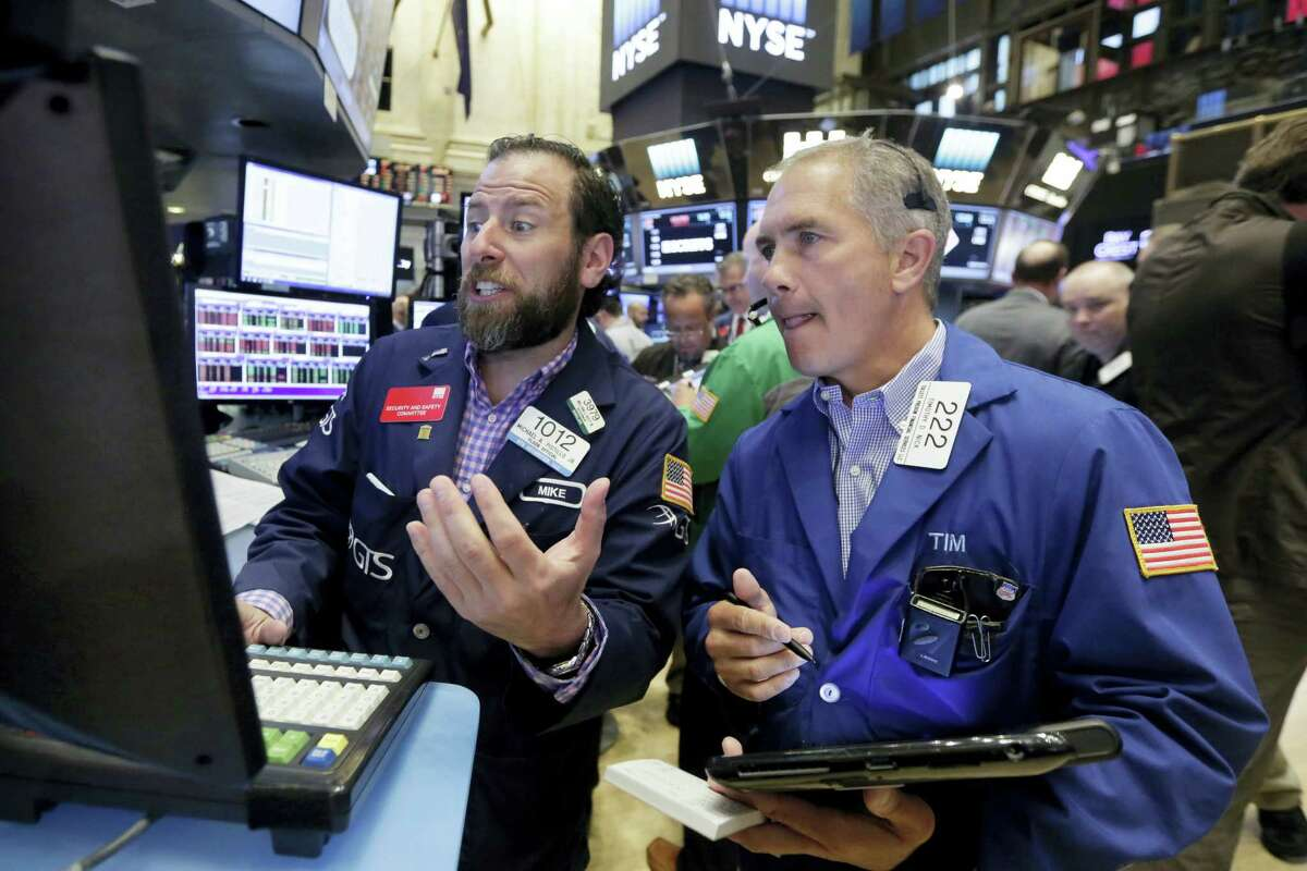 Specialist Michael Pistillo, left, and trader Timothy Nick work on the floor of the New York Stock Exchange Friday.